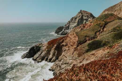 rocky mountain beside sea